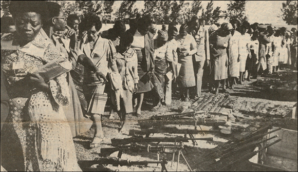 OMM delegates and captured weapons