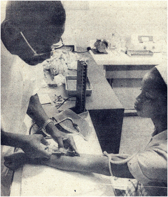 Drawing blood sample, Mozambique, 1980s